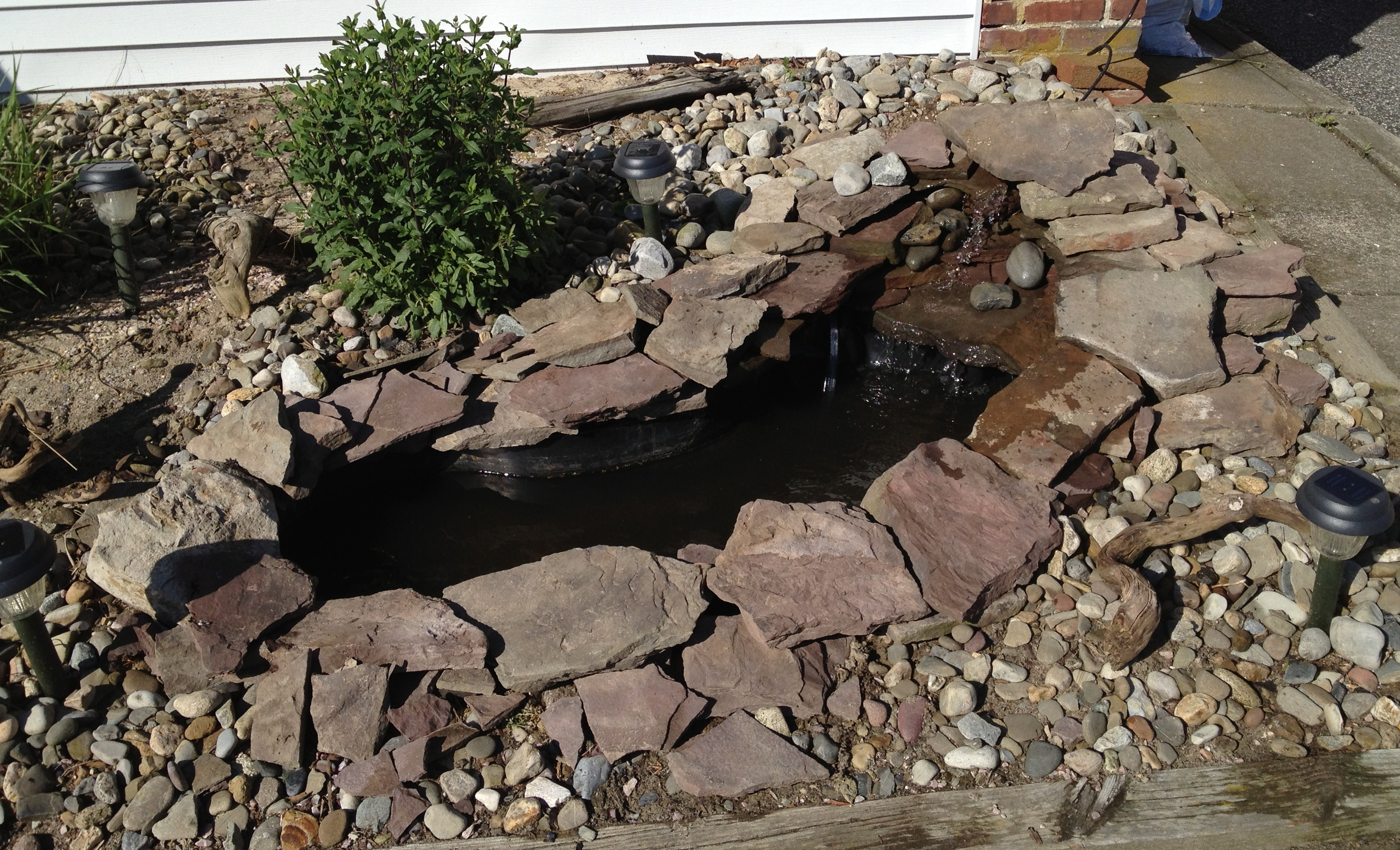How to build a garden waterfall pond a girl 39 s guide to diy for Diy ponds and waterfalls